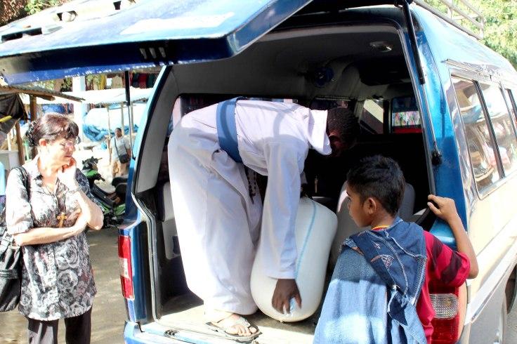 Br Emmanuel loading sacks of rice (4 June 2013)