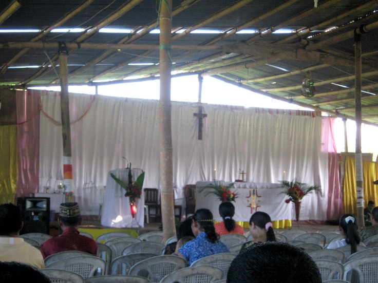 Sunday mass in bamboo church with tin roof (2 June 2013)