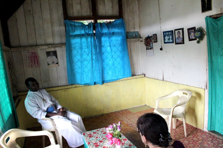 Visiting widow's home (5 June 2013)