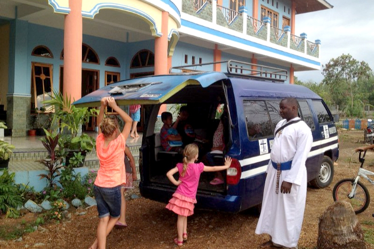 Taking local children back home after Peter and the girls took the catechism class