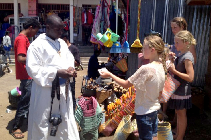 Girls learning to shop at the local markets with Brother Emmanuel