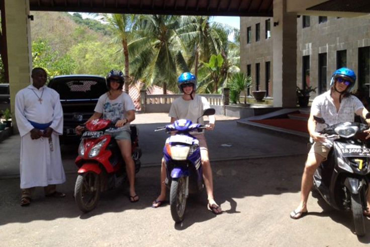 The boys, Matt, Rob and Luke hire motor bikes to follow the Missionaries of the Poor van; Brother Emmanuel likes the idea