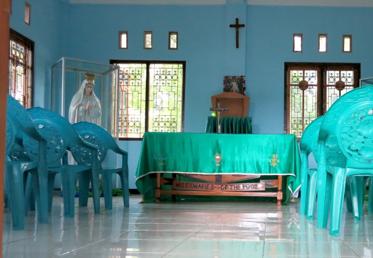 Time for the rosary, the chapel has a new hand carved altar and a beautiful altar cloth