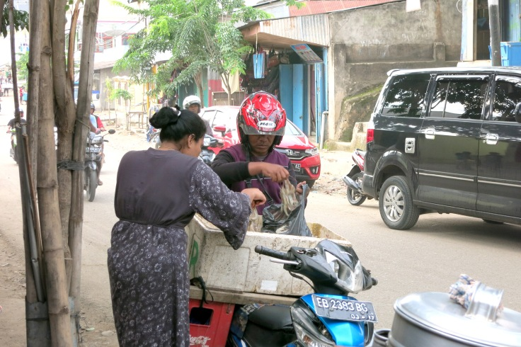 12. Some seafood sold from the back of a motorcycle