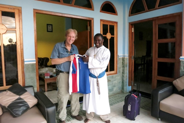 23. Brother Emmanuel receiving donations of school uniforms from Ambrose Treacy College, Brisbane