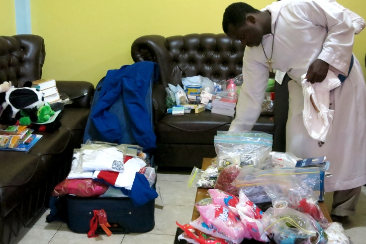 24. Unpacking supplies brought up from Australia