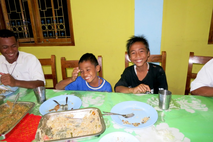 25. Sponsor child Devonne on right with Angel on left having dinner with the brothers
