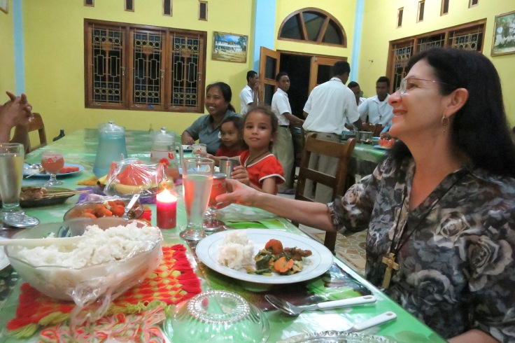 31. Sharing dinner with sponsor children and their families