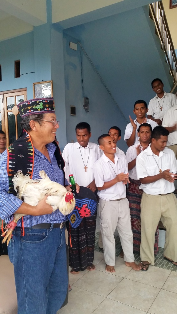 Heru also receiving the customary greeting with a chicken