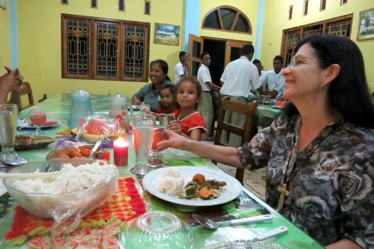 Melani sharing dinner at the monastery with Devon's Mum and brother, with Tina in foreground (2015)
