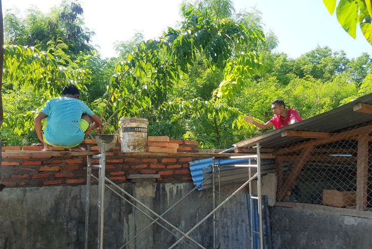 16. The brothers turning their hands to brick laying