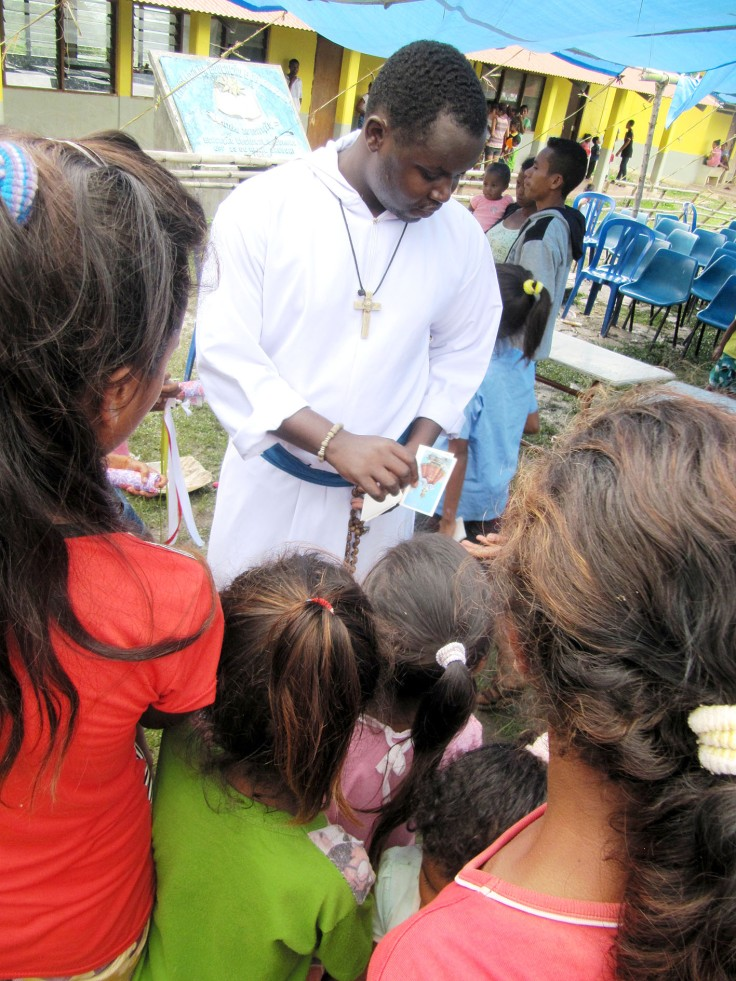 4. Br Emmanuel gives out Holy Cards after the children have eaten