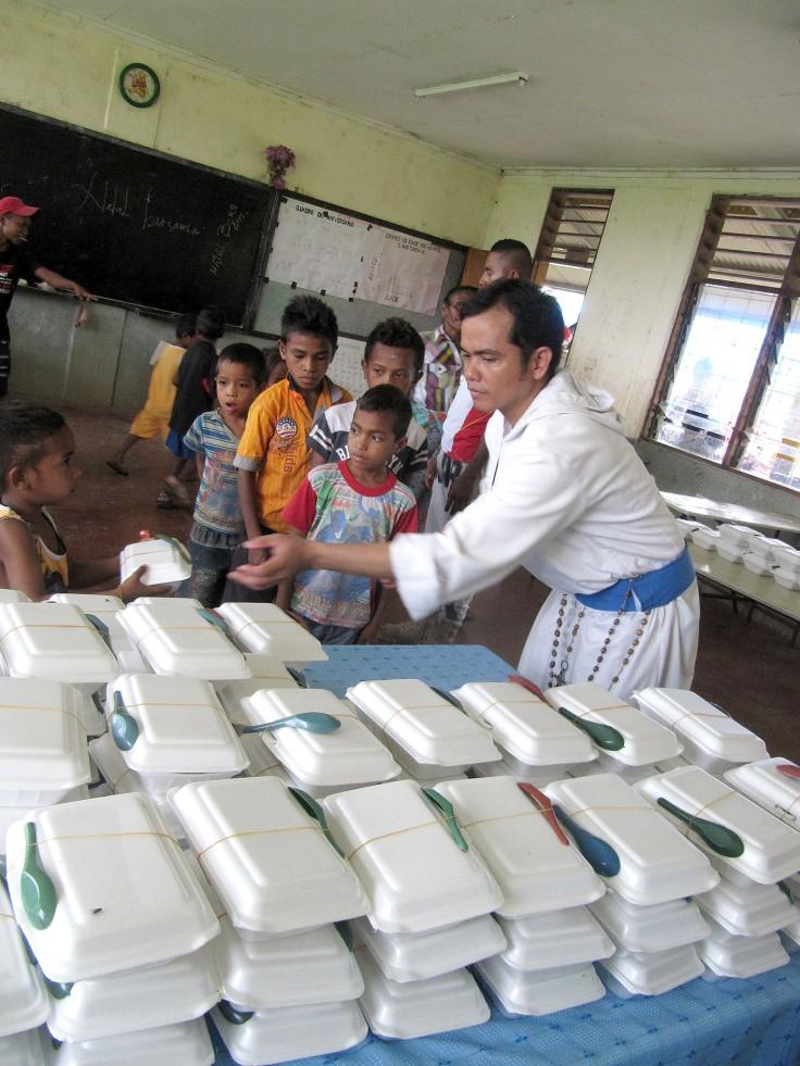 8. Children's feeding program with Br Jimmy