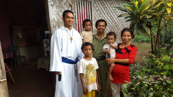 5. Br Marc with sponsor child Giu with his family