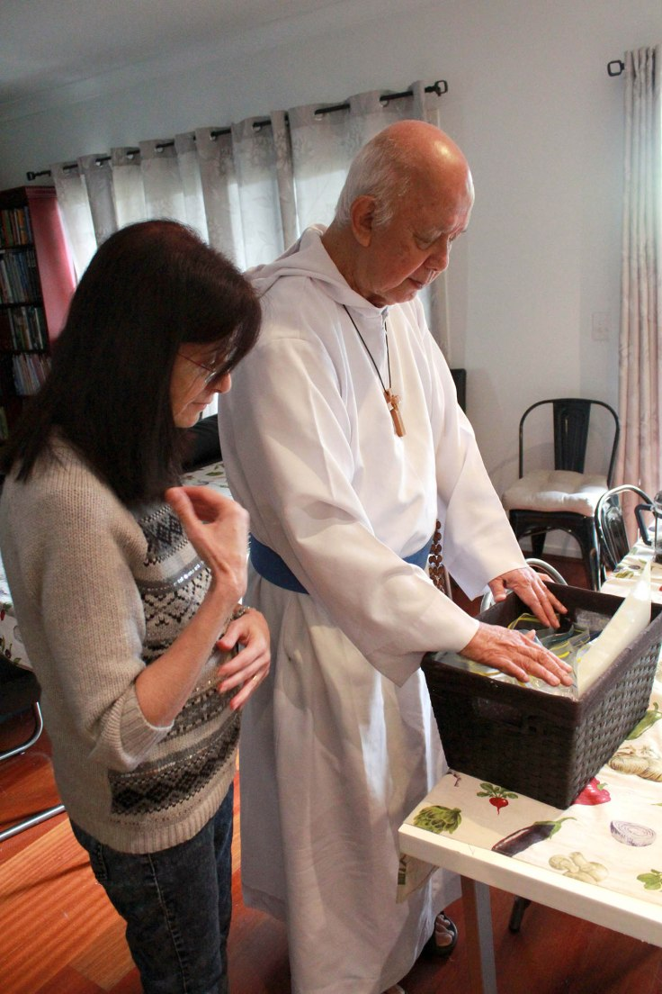 15. Father blessing our handmade rosaries