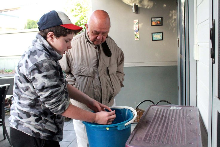 16. Father with Trevor and Tina's grandson Alexander sharing their love of aquarium fish