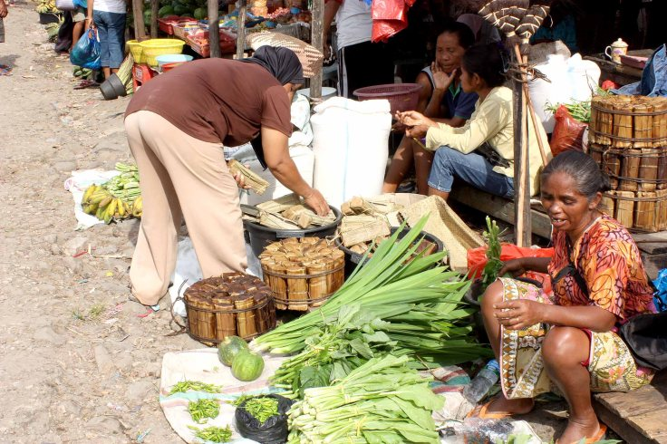 9. Greens for sale at the local markets with palm sugar wrapped in banana leaves