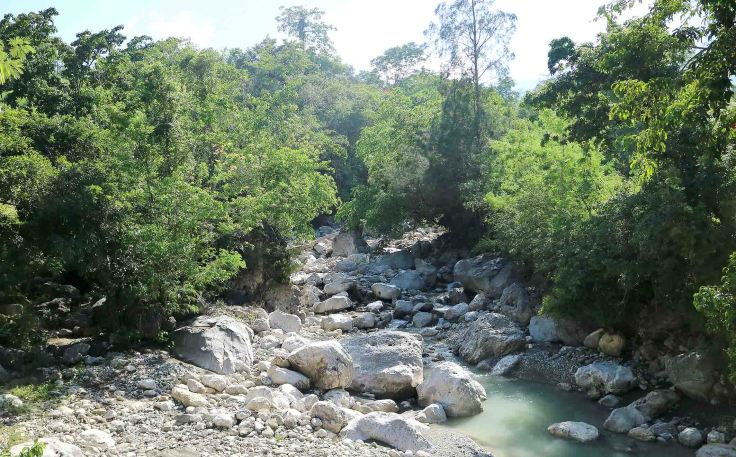 travelling-over-one-of-the-creeks-up-to-saburai