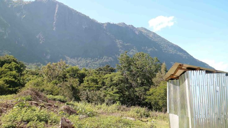 we-reach-the-brothers-property-looking-up-to-saburai-mountain-their-shed-in-the-foreground