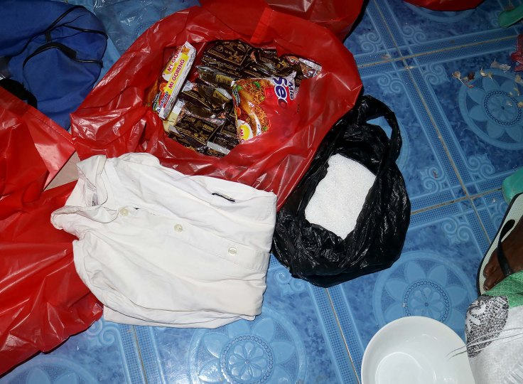 4-food-parcel-contents-sugar-rice-noodles-coffee-and-a-piece-of-clothing
