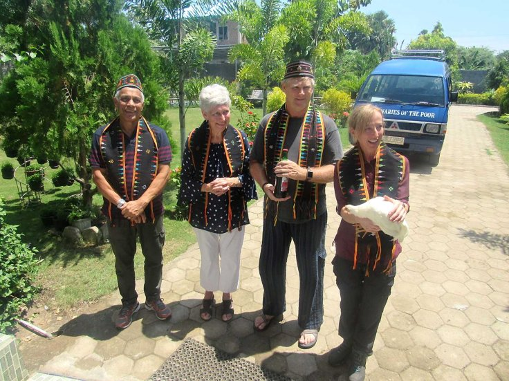 1.Some of the visitors arriving at the mission in Labuan Bajo, and greeted with the traditional chicken